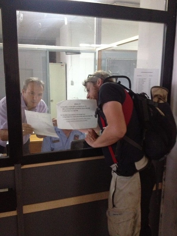 Jan getting very close to the customs officer